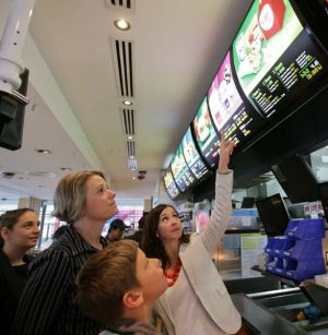 Guidance ... Kristina Keneally with her son Brendan and the McDonald's chief executive, Catriona Noble, in Waterloo.