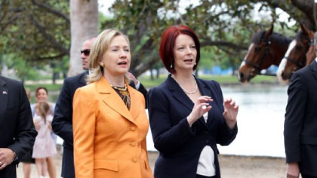 Power walking ... Hillary Clinton and Julia Gillard talk  on the banks of the Yarra River during a break from  meetings ...