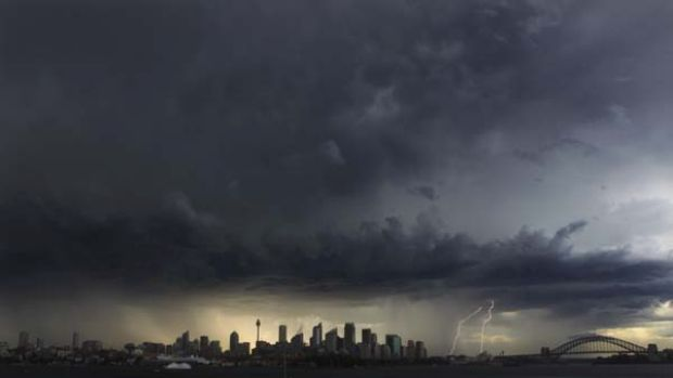 'Twas a dark and stormy afternoon ... the view from Bradleys Head yesterday captured the severe thunderstorms tracking ...