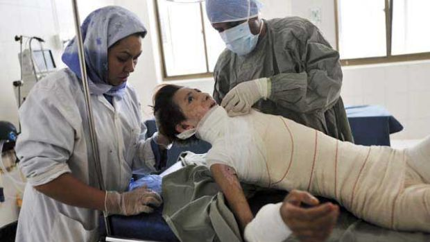 Hanife, 15, has her bandages changed after skin graft surgery at the Herat burns hospital.