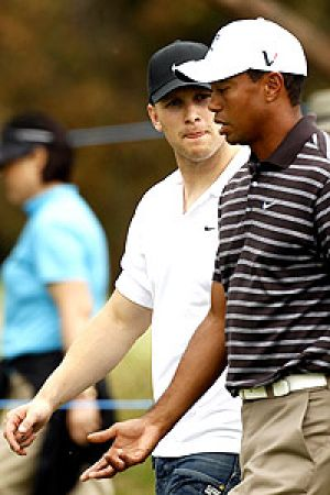 Gary Ablett gets a close look at Tiger Woods yesterday.