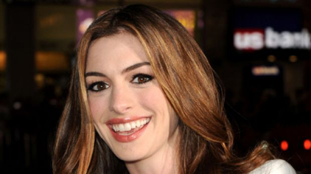Not wrinkles, smile lines ... Anne Hathaway laughs off Botox pressure.