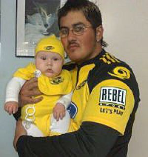 Eddie Wetere, pictured here with his son, who was found dead last night at Hillarys Boat Harbour.