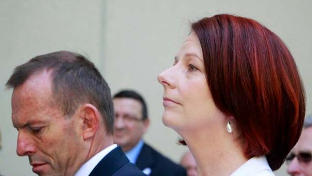Four months on ... Julia Gillard must prove she can deliver as Tony Abbott comes to terms with defeat.