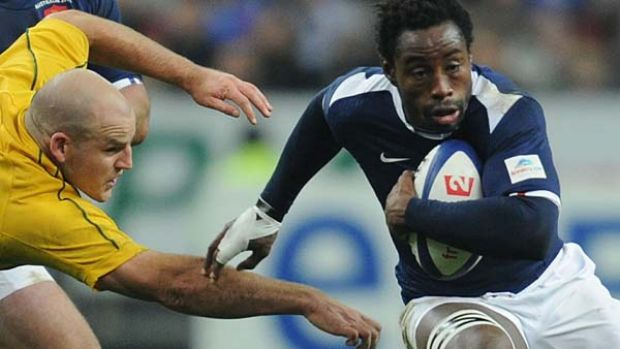 French flanker Fulgence Ouedraogo charges past Australian hooker Stephen Moore.