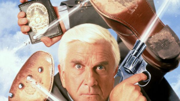 Neilsen as hapless detective Frank Drebin in The Naked Gun series.