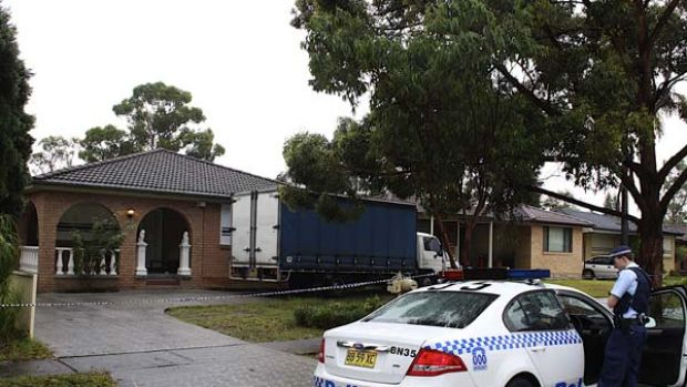 Man shot ... police cordon off the house in Doonside.