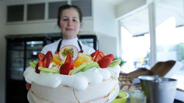 Sweet temptation ... Noga Maman, of Noga's Cuisine at Bondi, with a pavlova, which the Oxford English Dictionary has ...