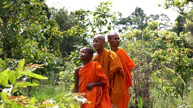Sorng Rukavorn monks Sove Ui, Kea Mony Tapkea and Sou Mai in their community forest in Oddar Meanchey, northern Cambodia.