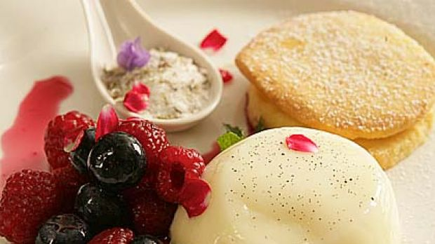 Mount Kembla Hotel's vanilla bean panna cotta with berries, orange blossom, sable biscuits and lavender sherbet.