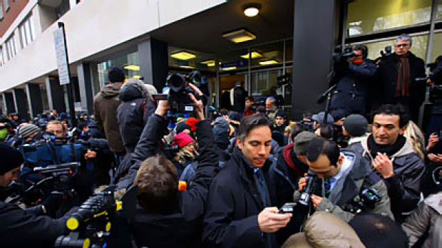 Members of the media gather outside the rear entrance of Westminster Magistrates Court in London.