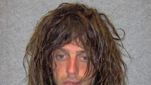 Police have launched a manhunt for James D'Zilva following the stabbing of a police officer in Healesville overnight.