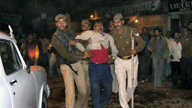 Indian police help an injured victim after the explosion in Varanasi.