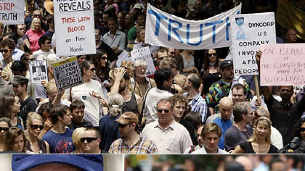 A tale of two cities ... the protest in Sydney for the WikiLeaks' founder, and the fans turn out for Oprah in Melbourne.