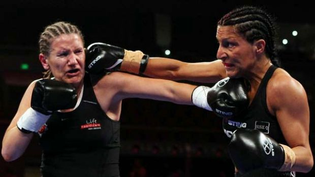 Susie Ramadan (right) finds the target during her win over New Zealand's Michelle Preston.