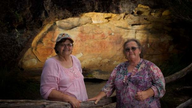"""""""It's our health, it's our wealth"""" ... Anita Selwyn and Barbara Grew in front of a cave with Aboriginal hand stencils at ..."""