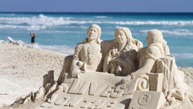 Urgent plea ... a sand sculpture made by activists from charity group Oxfam in Cancun, Mexico, the host city for the ...
