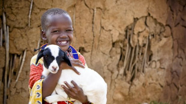 A little boy and his charity goat, featured in this year's World Vision Smiles campaign.