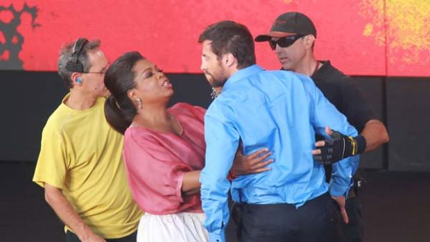 Ouch ... Hugh Jackman's ride from the sails of the Opera House ended with a crash landing and a gentle touch from Oprah ...