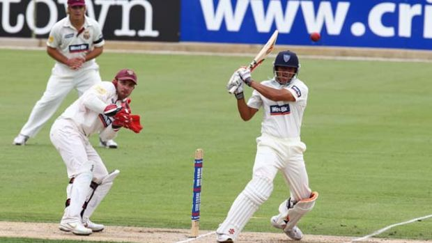 Promising start ... Usman Khawaja plays a confident shot against the Queensland attack but later missed a full toss to ...
