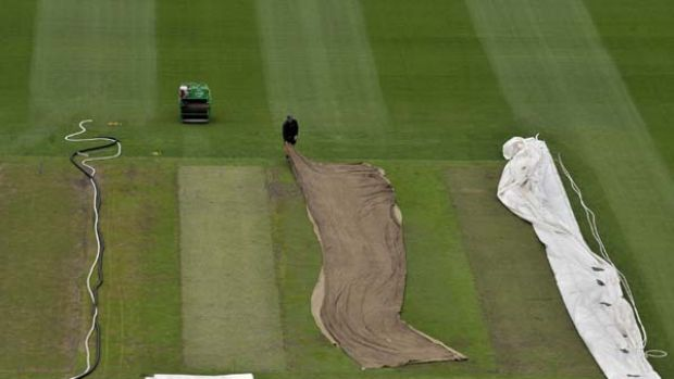 Roller decks ... groundsmen tend to the wicket at the MCG before the fourth Test.