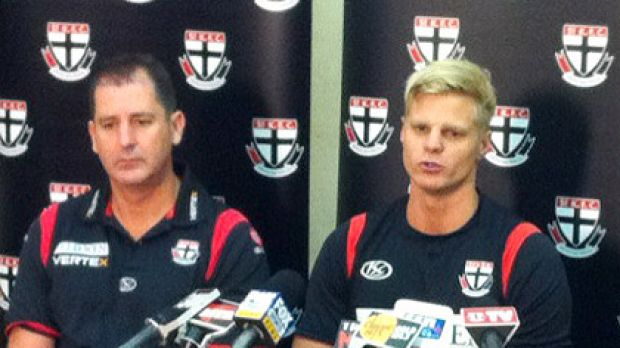 Nick Riewoldt (right), pictured with St Kilda coach Ross Lyon, addresses the media over the publication of a naked photo ...