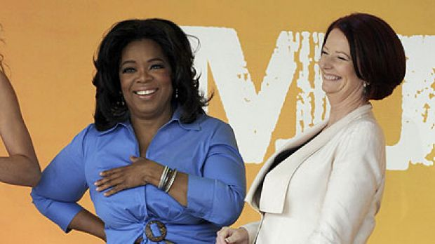 Julia Gillard on stage with Oprah.