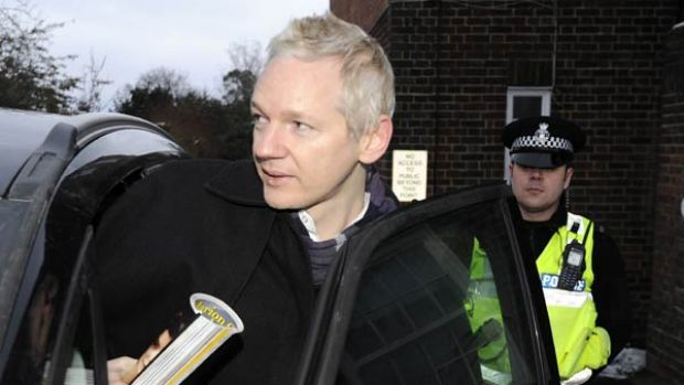 Julian Assange visits a police station as part of his bail terms.