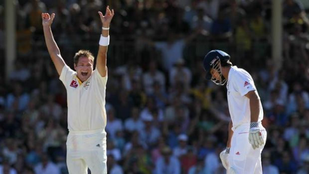 Ryan Harris, left, celebrates the wicket of Alastair Cook in Perth.