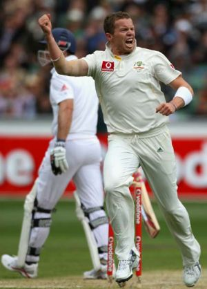 Peter Siddle celebrates the wicket of Andrew Strauss.