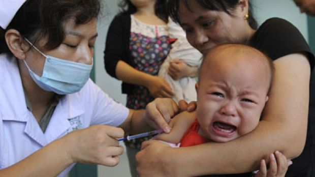 A child gets vaccinated for measles.