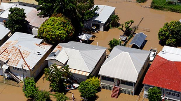 Flooded houses in Rockhampton, photographed yesterday. The waters are expected to peak today.