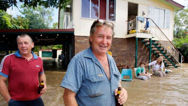 Making the best of it ... David Byrne, Max Wood, Dean Walsh and Deanna Walsh at Max and Deanna's home in Rockhampton ...