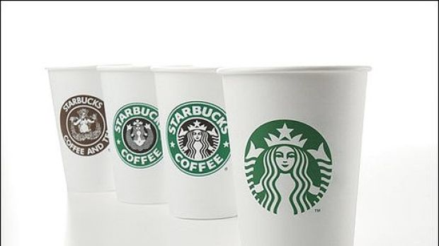 The new logo and, in the background, cups with earlier logos, from left: 1971, 1987 and 1992.