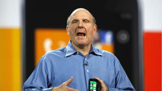 Microsoft CEO Steve Ballmer holds a Windows 7 phone during his keynote address on the eve of the Consumer Electronics ...