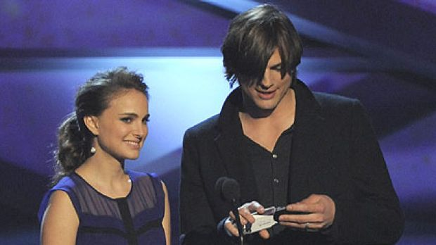 A pregnant Natalie Portman and co-presenter Ashton Kutcher announce nominees for the favorite movie award at the 2011 ...