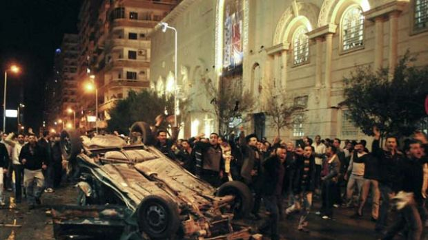 Worshippers in Alexandria shout around the exploded car in Alexandria.