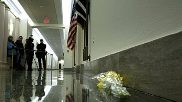 Flowers lie outside the office of Gabrielle Giffords in the Longworth House Office Building on Capitol Hill in ...