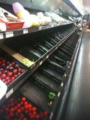 Brisbane's grocery stores have been largely stripped bare and face difficulty restocking.