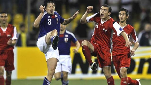 Japan's Daisuke Matsui (left) in action against Syria's Abdulfatah Al Aghaduring their AFC Asian Cup match in Doha.