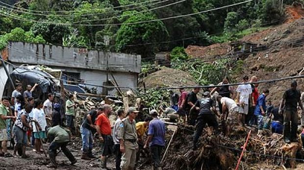 Rescue workers search for victims after heavy rains caused mudslides in a low-income neughbourhood in Teresopolis, some ...