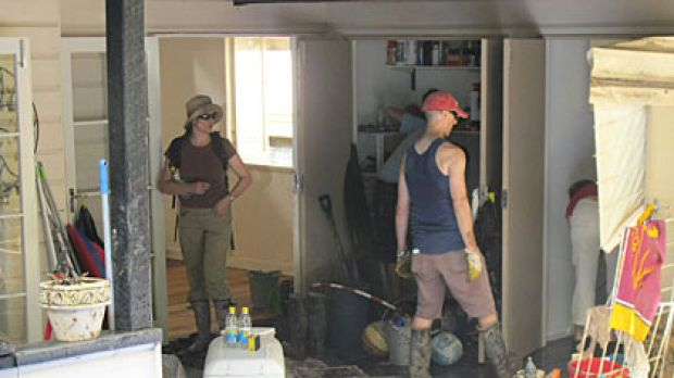 Volunteers rush to get the Moores' house clean before they return from holidays.