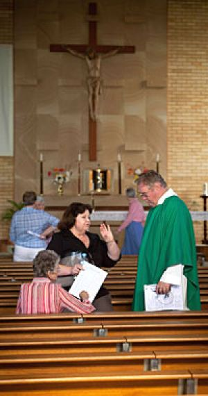 Father John Conway speak to parishioners after the service in Gatton.