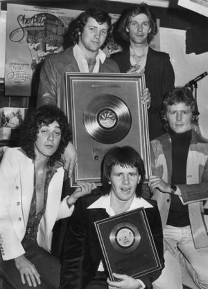 Australian  pop group Sherbet, with their gold single for their record <i>Howzat</i> in 1976. From left to right, Alan ...