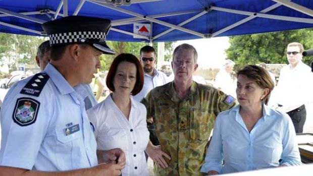 Queensland Police Inspector Mark Kelly briefs Julia Gillard, Anna Bligh and the Head of the Queensland Flood Recovery ...