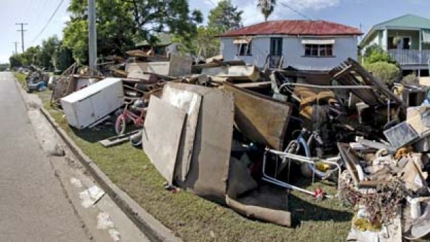 Not quite your average council clean-up ... in the low-lying Brisbane suburb of Rocklea residents turned their homes ...