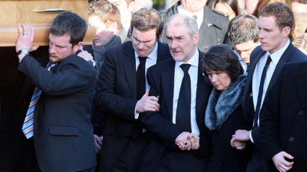 Dark days again ... parents John and Marian Harte and husband John McAreavey (above, right) at the funeral of Michaela ...