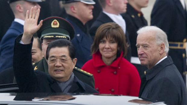 Warm welcome ... President Hu Jintao waves to well-wishers at Andrews Air Force Base, where he was greeted by the US ...