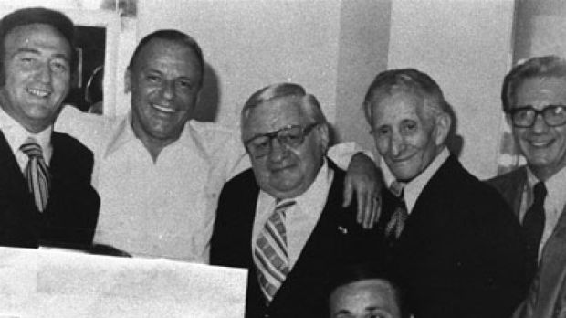 Richard Fusco (bottom) and other mobsters with Frank Sinatra in 1976,