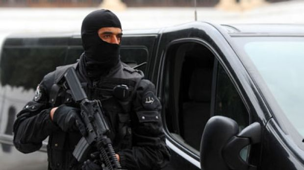 A member of the Tunisian President Security Force stands guard in front of the government Palace in the kasbah in Tunis.